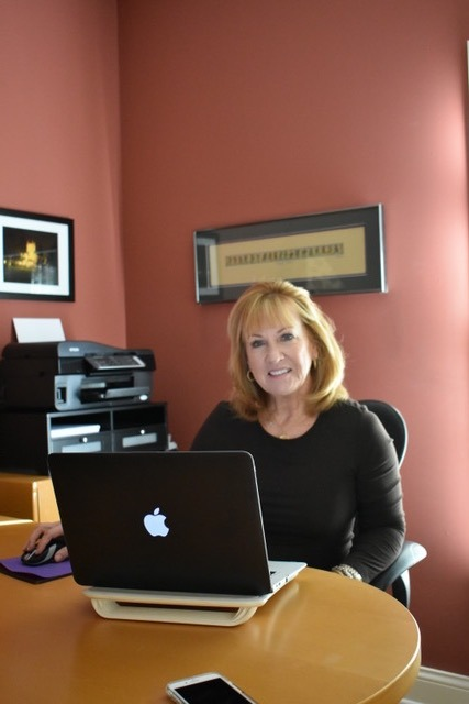 Sherry sitting at a desk